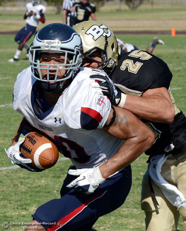 . Butte College\'s #25 Gooden De\'Aundray (right) tackles against College of the Siskiyous\' #80 Sam Williams (left) in the third quarter of their football game at Butte\'s Cowan Stadium on Saturday, September 14, 2013, in Oroville, Calif. (Jason Halley/Chico Enterprise-Record)