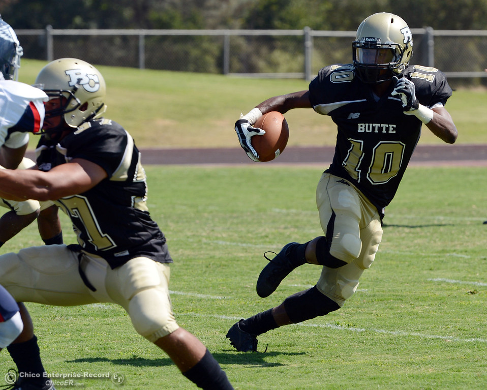 . Butte College\'s #10 CJ Grice rushes against College of the Siskiyous in the second quarter of their football game at Butte\'s Cowan Stadium on Saturday, September 14, 2013, in Oroville, Calif. (Jason Halley/Chico Enterprise-Record)
