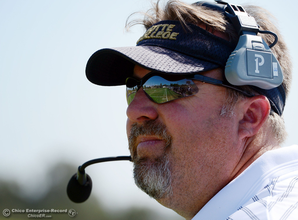 . Butte College head coach Jeff Jordan looks on against College of the Siskiyous in the first quarter of their football game at Butte\'s Cowan Stadium on Saturday, September 14, 2013, in Oroville, Calif. (Jason Halley/Chico Enterprise-Record)