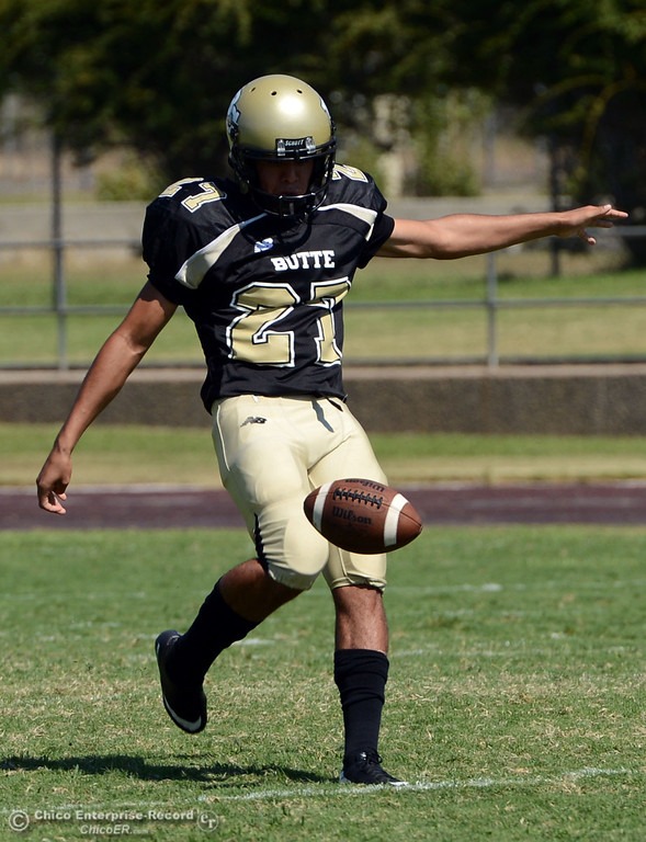 . Butte College\'s #27 Rigoberto Sanchez punts against College of the Siskiyous in the first quarter of their football game at Butte\'s Cowan Stadium on Saturday, September 14, 2013, in Oroville, Calif. (Jason Halley/Chico Enterprise-Record)