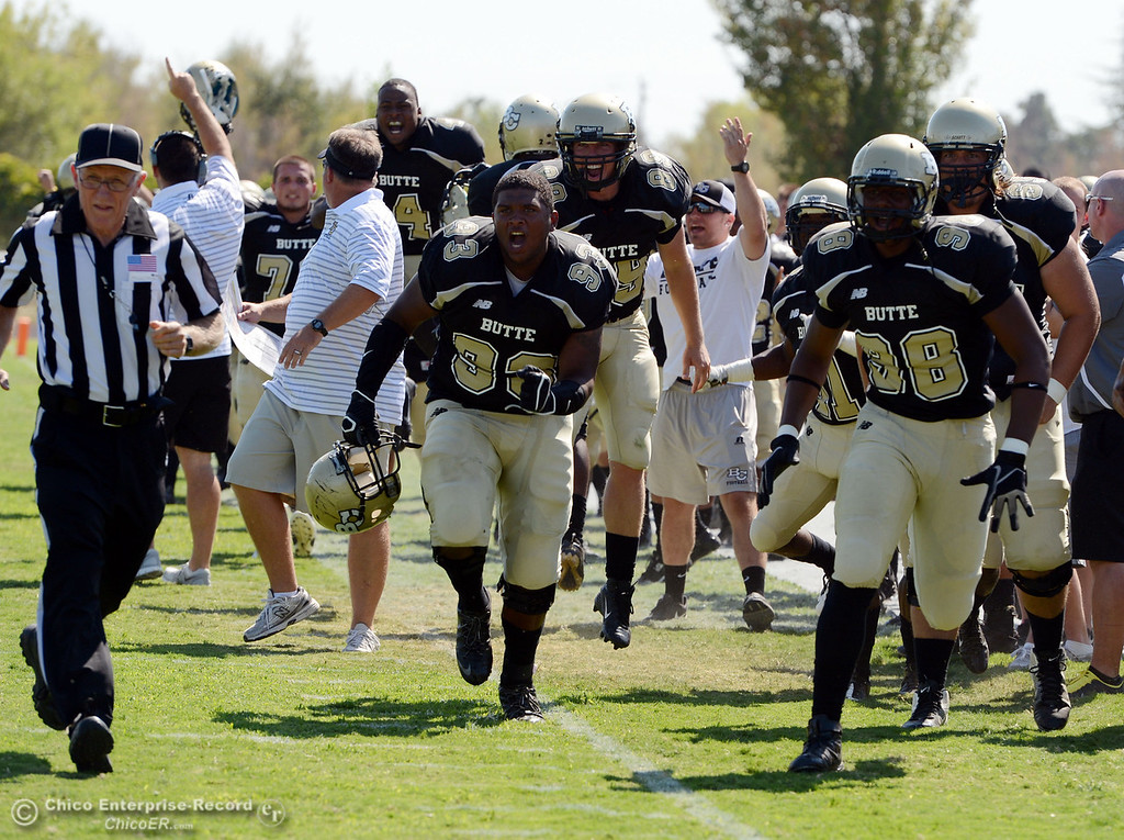 . Butte College reacts to a touchdown against College of the Siskiyous in the second quarter of their football game at Butte\'s Cowan Stadium on Saturday, September 14, 2013, in Oroville, Calif. (Jason Halley/Chico Enterprise-Record)