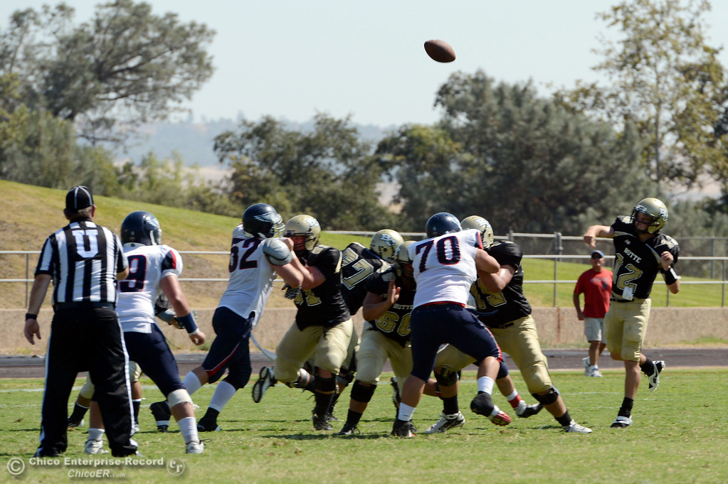 . Butte College\'s #12 Thomas Stuart (right) attempts a deep pass against College of the Siskiyous in the second quarter of their football game at Butte\'s Cowan Stadium on Saturday, September 14, 2013, in Oroville, Calif. (Jason Halley/Chico Enterprise-Record)