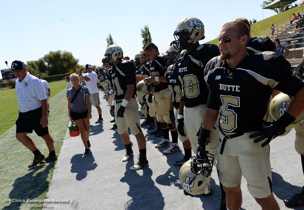 . Butte College\'s #5 David Brannon (right) looks on against College of the Siskiyous in the first quarter of their football game at Butte\'s Cowan Stadium on Saturday, September 14, 2013, in Oroville, Calif. (Jason Halley/Chico Enterprise-Record)