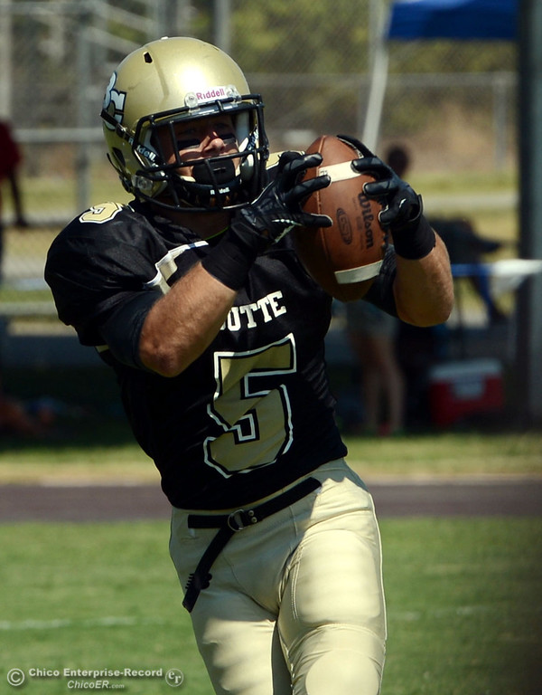 . Butte College\'s #5 David Brannon completes a catch against College of the Siskiyous in the first quarter of their football game at Butte\'s Cowan Stadium on Saturday, September 14, 2013, in Oroville, Calif. (Jason Halley/Chico Enterprise-Record)