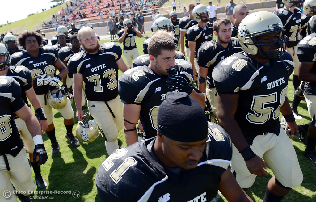 . Butte College\'s team walks off the field against College of the Siskiyous at the end of the half of their football game at Butte\'s Cowan Stadium on Saturday, September 14, 2013, in Oroville, Calif. (Jason Halley/Chico Enterprise-Record)