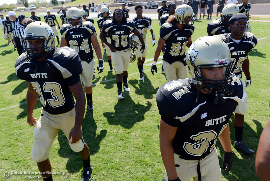 . Butte College\'s #33 Jariah Booker (left) #31 Ted Staiger (right) and others walk off the field against College of the Siskiyous at the end of the half of their football game at Butte\'s Cowan Stadium on Saturday, September 14, 2013, in Oroville, Calif. (Jason Halley/Chico Enterprise-Record)