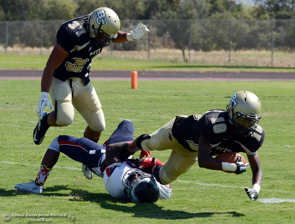 . Butte College\'s #37 Demetre Lopez (left) avoids #10 CJ Grice (right) tackled against College of the Siskiyous\' #29 Yves Nguessan (bottom)  in the second quarter of their football game at Butte\'s Cowan Stadium on Saturday, September 14, 2013, in Oroville, Calif. (Jason Halley/Chico Enterprise-Record)