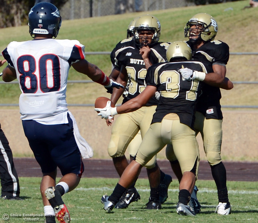 . Butte College\'s #33 Jariah Booker, #37 Demetre Lopez ,and #3 London Muse (left to right) react to breaking up a pass against College of the Siskiyous in the fourth quarter of their football game at Butte\'s Cowan Stadium on Saturday, September 14, 2013, in Oroville, Calif. (Jason Halley/Chico Enterprise-Record)