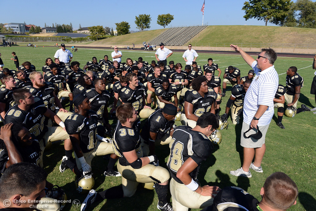 . Butte College head coach Jeff Jordan (right) talks to the team at the end of their football game against College of the Siskiyous at Butte\'s Cowan Stadium on Saturday, September 14, 2013, in Oroville, Calif. (Jason Halley/Chico Enterprise-Record)