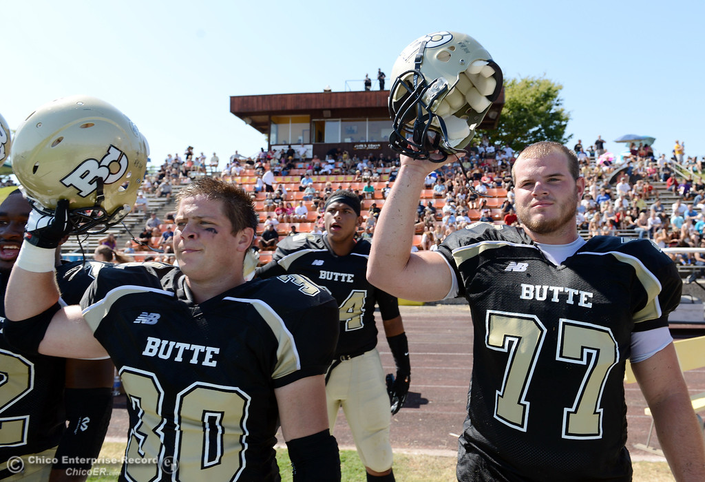 . Butte College\'s #30 Eric DeLucchi (left) and #77 Scott Batchelder (right) prepare for kickoff against College of the Siskiyous in the second quarter of their football game at Butte\'s Cowan Stadium on Saturday, September 14, 2013, in Oroville, Calif. (Jason Halley/Chico Enterprise-Record)