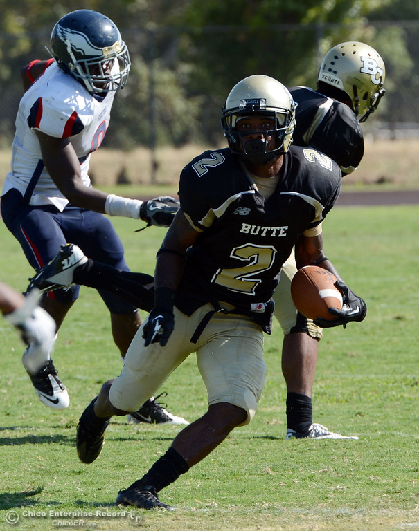 . Butte College\'s #2 Deonte Flemings rushes against College of the Siskiyous in the third quarter of their football game at Butte\'s Cowan Stadium on Saturday, September 14, 2013, in Oroville, Calif. (Jason Halley/Chico Enterprise-Record)