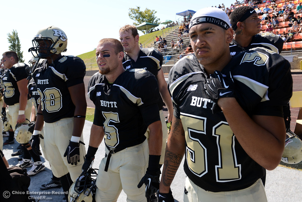 . Butte College\'s #98 Demontra McNealy, #5 David Brannon, and #51 Izaya Johnson (left to right) look on against College of the Siskiyous in the first quarter of their football game at Butte\'s Cowan Stadium on Saturday, September 14, 2013, in Oroville, Calif. (Jason Halley/Chico Enterprise-Record)