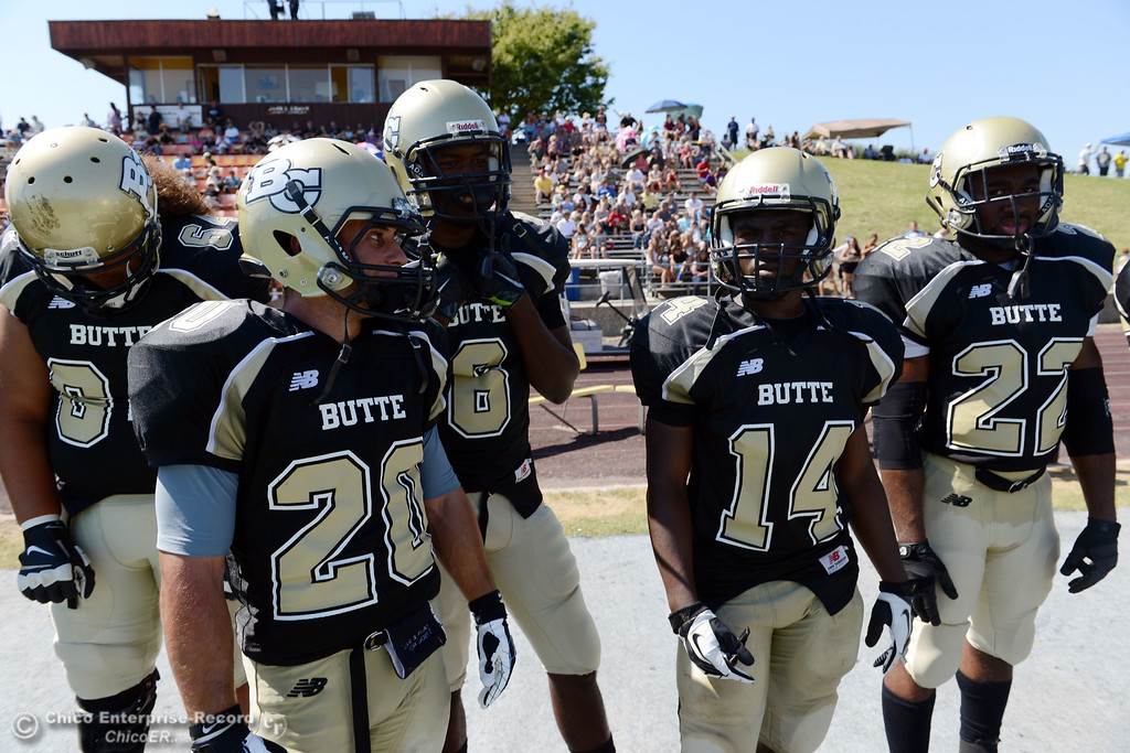. Butte College\'s #64 Jess Savusa, #20 Armand Bokitch, #6 Denzel Conyers, #14 Robert Frazier, and #22 Quinta Thomas (left to right) against College of the Siskiyous in the second quarter of their football game at Butte\'s Cowan Stadium on Saturday, September 14, 2013, in Oroville, Calif. (Jason Halley/Chico Enterprise-Record)