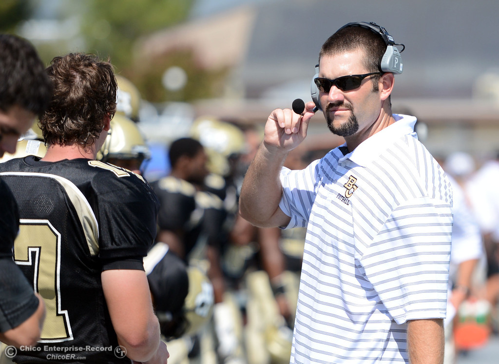 . Butte College coach Rob Snelling looks on against College of the Siskiyous before the first quarter of their football game at Butte\'s Cowan Stadium on Saturday, September 14, 2013, in Oroville, Calif. (Jason Halley/Chico Enterprise-Record)