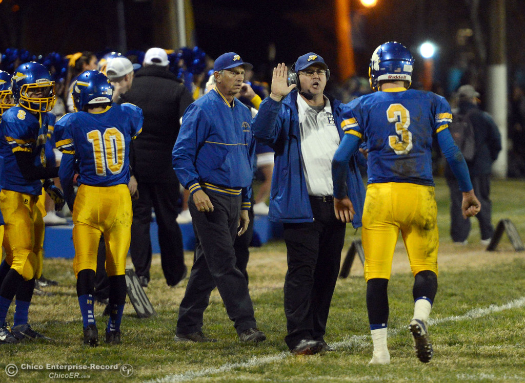 . Hamilton High\'s coach Ryan Bentz (center) congratulates #3 Austin Burbank (right) on scoring a touchdown against Winters High in the second quarter of their football game at HHS Wednesday, November 27, 2013 in Hamilton City, Calif.  (Jason Halley/Chico Enterprise-Record)