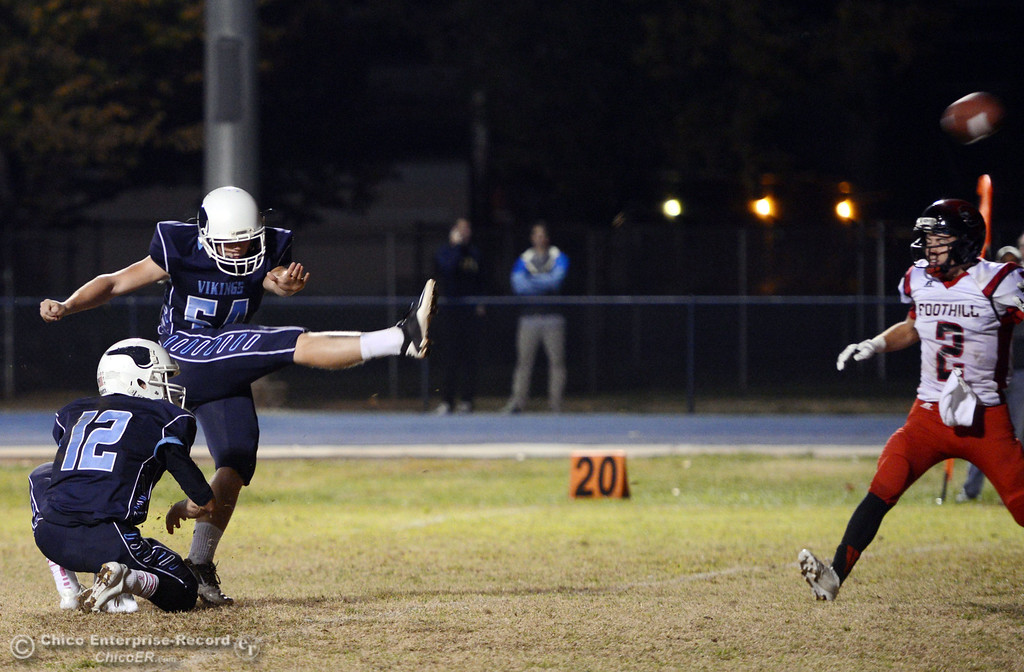. Pleasant Valley High\'s #12 Trent Darms (bottom) holds for the extra point kick by #54 Zack Gillam (top) against Foothill High in the third quarter of their football game at PVHS Asgard Yard Friday, October 11, 2013 in Chico, Calif.  (Jason Halley/Chico Enterprise-Record)