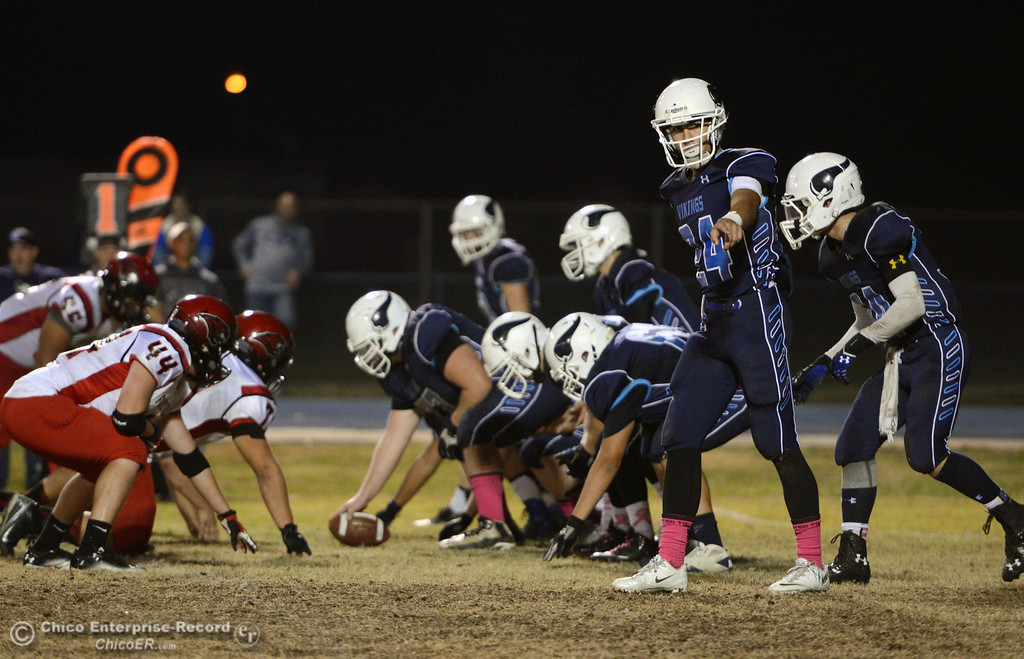 . Pleasant Valley High\'s #24 Jack Soza (right) points out the line against Foothill High in the second quarter of their football game at PVHS Asgard Yard Friday, October 11, 2013 in Chico, Calif.  (Jason Halley/Chico Enterprise-Record)