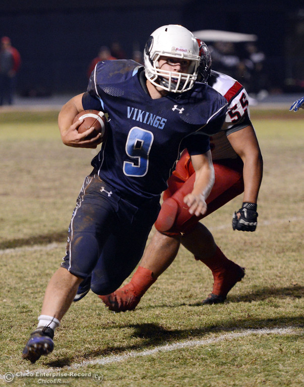 . Pleasant Valley High\'s #9 Houston McGowan rushes against Foothill High in the third quarter of their football game at PVHS Asgard Yard Friday, October 11, 2013 in Chico, Calif.  (Jason Halley/Chico Enterprise-Record)