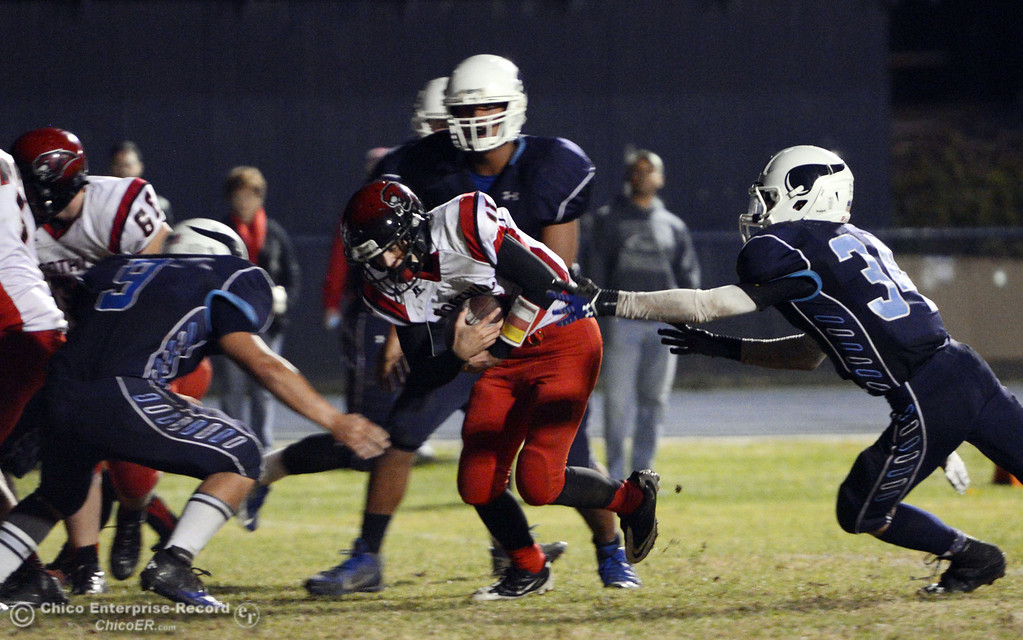 . Pleasant Valley High\'s #9 Houston McGowan (left) and #34 Cale Crawford (right) tackle against Foothill High\'s #15 Ryan Pollard (center) in the third quarter of their football game at PVHS Asgard Yard Friday, October 11, 2013 in Chico, Calif.  (Jason Halley/Chico Enterprise-Record)