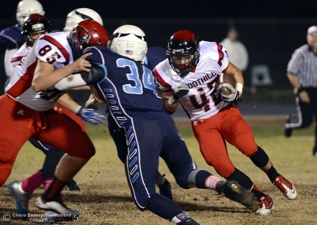 . Pleasant Valley High against Foothill High\'s #42 Tyler Duclos (right) rushes in the first quarter of their football game at PVHS Asgard Yard Friday, October 11, 2013 in Chico, Calif.  (Jason Halley/Chico Enterprise-Record)