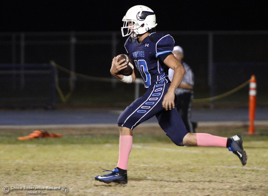 . Pleasant Valley High\'s #10 Tucker LaRue carries back a kickoff return against Foothill High in the second quarter of their football game at PVHS Asgard Yard Friday, October 11, 2013 in Chico, Calif.  (Jason Halley/Chico Enterprise-Record)