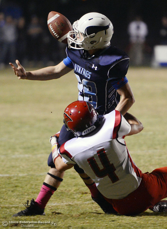 . Pleasant Valley High\'s #28 Dylan Batie (top) bobbles a fumble which he ultimately was able to recover against Foothill High\'s #4 Luke Kelly (bottom) in the first quarter of their football game at PVHS Asgard Yard Friday, October 11, 2013 in Chico, Calif.  (Jason Halley/Chico Enterprise-Record)