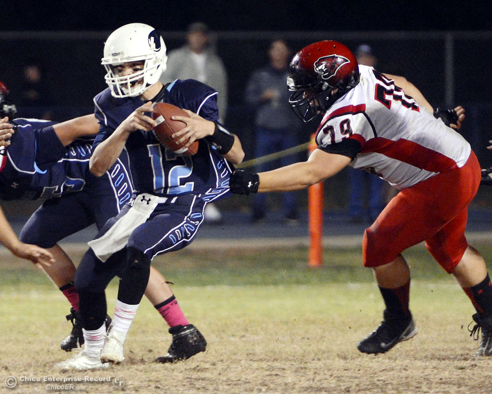 . Pleasant Valley High\'s #12 Trent Darms (left) is tackled against Foothill High\'s #79 Wyatt Landreth (right) in the second quarter of their football game at PVHS Asgard Yard Friday, October 11, 2013 in Chico, Calif.  (Jason Halley/Chico Enterprise-Record)