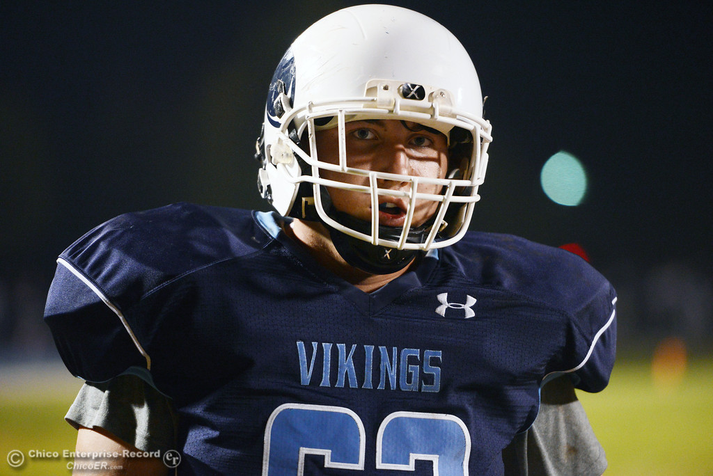 . Pleasant Valley High\'s #63 Harrison Carter warms up against Foothill High before the first quarter of their football game at PVHS Asgard Yard Friday, October 11, 2013 in Chico, Calif.  (Jason Halley/Chico Enterprise-Record)