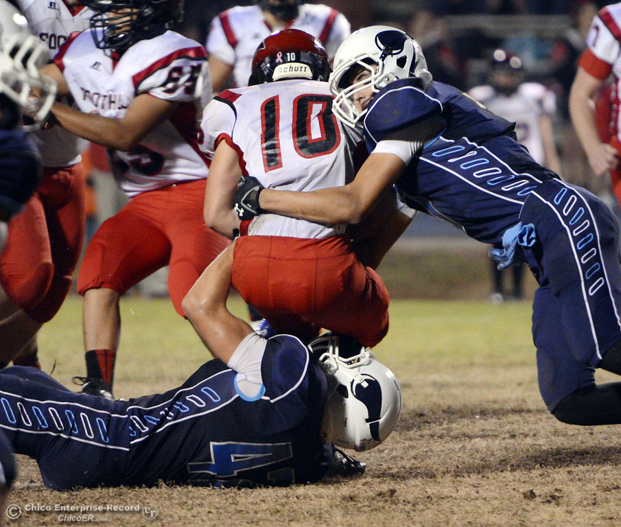 . Pleasant Valley High\'s #42 Chad Olsen (bottom) and #7 Zane Ferguson (right) tackle against Foothill High\'s #10 Blake Burnett (center) in the second quarter of their football game at PVHS Asgard Yard Friday, October 11, 2013 in Chico, Calif.  (Jason Halley/Chico Enterprise-Record)