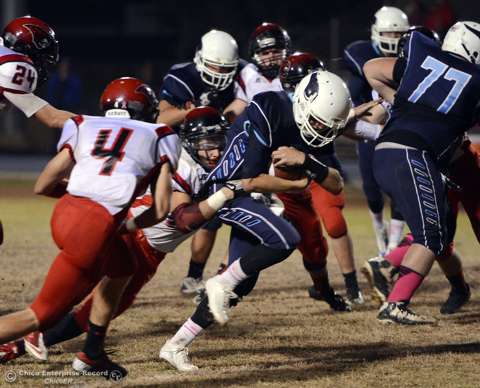 . Pleasant Valley High\'s #12 Trent Darms (right) is tackled against Foothill High\'s #42 Tyler Duclos (center) in the third quarter of their football game at PVHS Asgard Yard Friday, October 11, 2013 in Chico, Calif.  (Jason Halley/Chico Enterprise-Record)