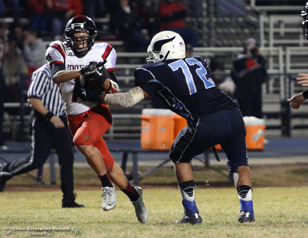 . Pleasant Valley High\'s #72 Christian Darden (right) is unable to tackle against Foothill High\'s #11 Ryan Terras (left) in the third quarter of their football game at PVHS Asgard Yard Friday, October 11, 2013 in Chico, Calif.  (Jason Halley/Chico Enterprise-Record)