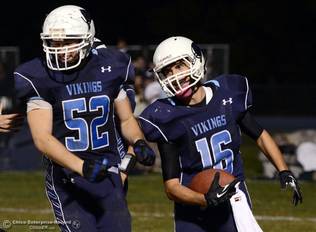 . Pleasant Valley High\'s #52 Riley Andrew congratulates #16 Trey Rosenbalm on scoring a touchdown (left to right) against Foothill High in the third quarter of their football game at PVHS Asgard Yard Friday, October 11, 2013 in Chico, Calif.  (Jason Halley/Chico Enterprise-Record)