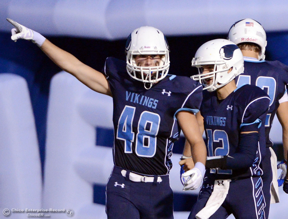 . Pleasant Valley High\'s #48 Logan O\'Sullivan (left) gestures after #42  Chad Olsen scored a touchdown against Lassen High in the first quarter of their football game at PVHS Asgard Yard Friday, September 6, 2013 in Chico, Calif. (Jason Halley/Chico Enterprise-Record)