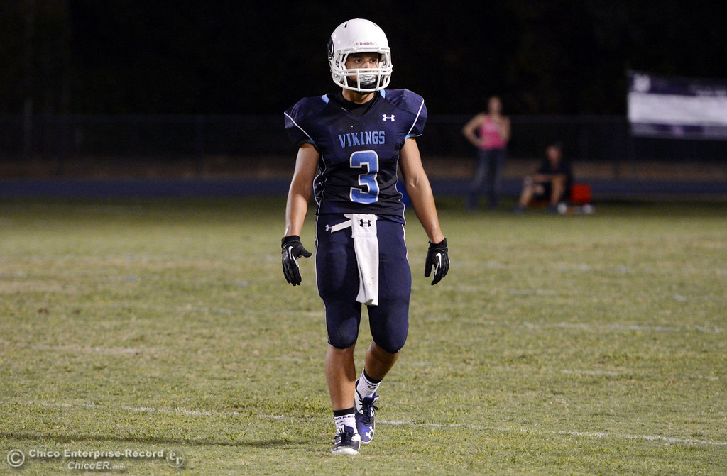 . Pleasant Valley High\'s #3 Brandon Romero looks on against Lassen High in the second quarter of their football game at PVHS Asgard Yard Friday, September 6, 2013 in Chico, Calif. (Jason Halley/Chico Enterprise-Record)