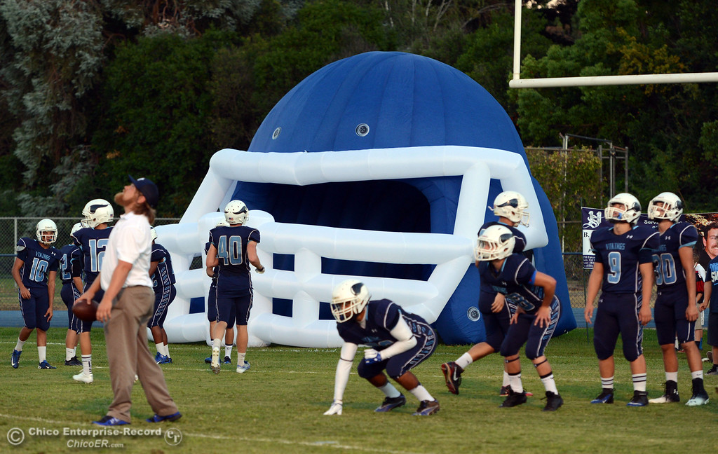 . Pleasant Valley High warms up against Lassen High before the first quarter of their football game at PVHS Asgard Yard Friday, September 6, 2013 in Chico, Calif. (Jason Halley/Chico Enterprise-Record)