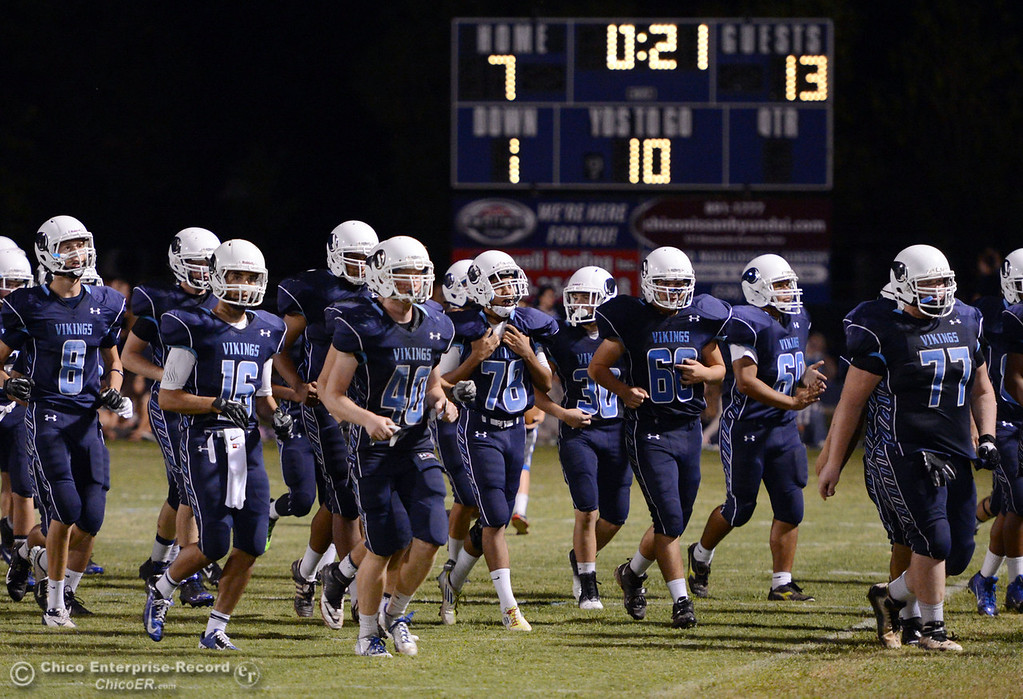. Pleasant Valley High\'s team takes the field against Lassen High in the third quarter of their football game at PVHS Asgard Yard Friday, September 6, 2013 in Chico, Calif. (Jason Halley/Chico Enterprise-Record)