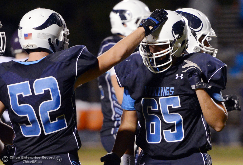 . Pleasant Valley High\'s #52 Riley Andrew (left) and #65 Michael Walker (right) against Lassen High in the third quarter of their football game at PVHS Asgard Yard Friday, September 6, 2013 in Chico, Calif. (Jason Halley/Chico Enterprise-Record)