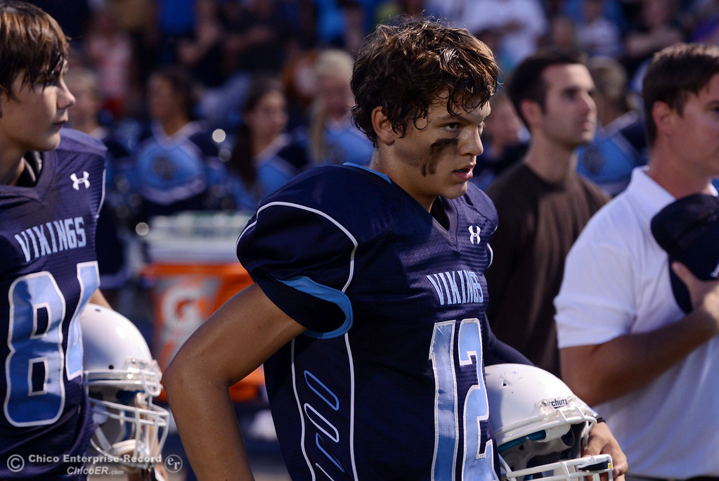 . Pleasant Valley High\'s #12 Trent Darms looks on against Lassen High before the first quarter of their football game at PVHS Asgard Yard Friday, September 6, 2013 in Chico, Calif. (Jason Halley/Chico Enterprise-Record)