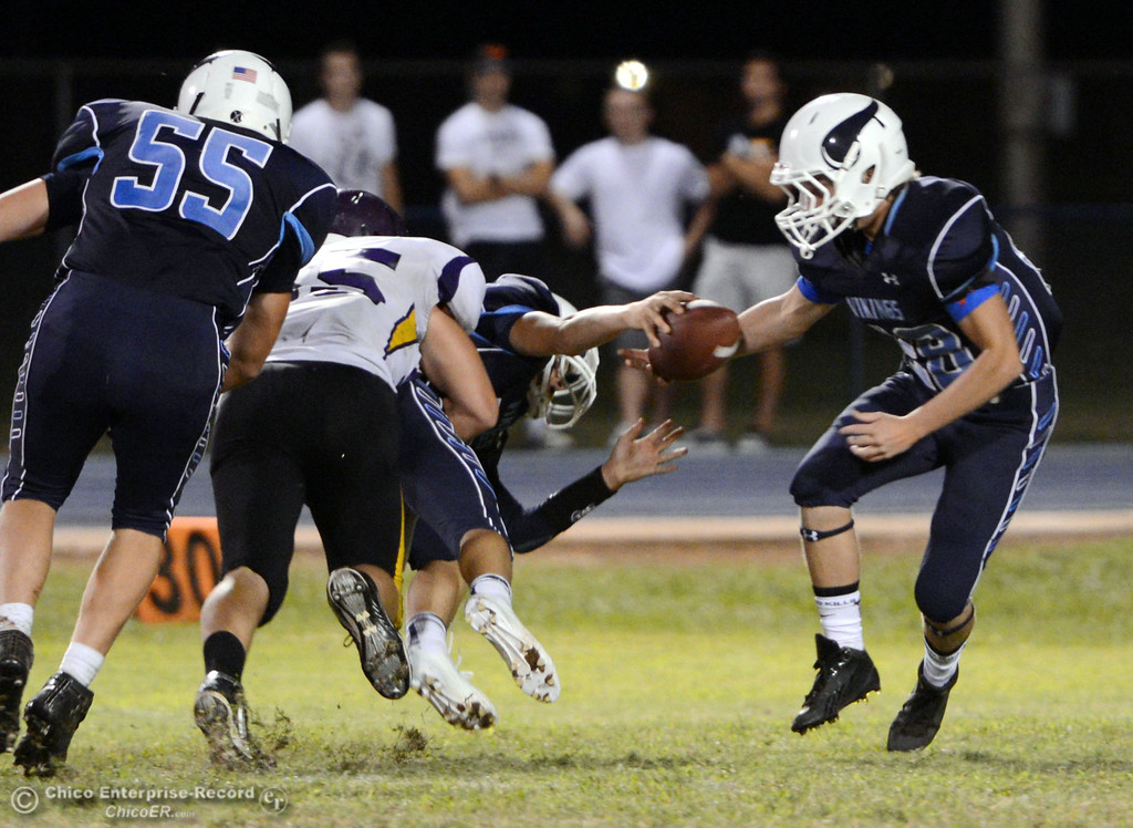 . Pleasant Valley High\'s #28 Dylan Batie (right) recovers a loose ball from #12 Trent Darms (center) who is tackled against Lassen High in the third quarter of their football game at PVHS Asgard Yard Friday, September 6, 2013 in Chico, Calif. (Jason Halley/Chico Enterprise-Record)