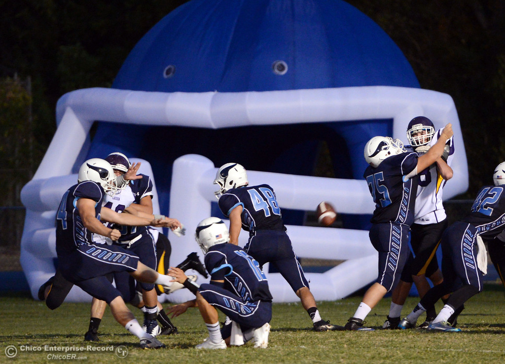 . Pleasant Valley High\'s #54 Zack Gillam (left) kicks the extra point against Lassen High in the first quarter of their football game at PVHS Asgard Yard Friday, September 6, 2013 in Chico, Calif. (Jason Halley/Chico Enterprise-Record)