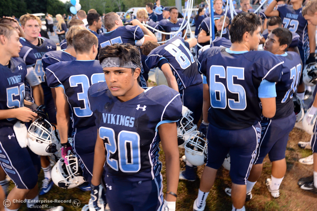 . Pleasant Valley High\'s #20 Bryan Esquivel (center) looks on against Lassen High before the first quarter of their football game at PVHS Asgard Yard Friday, September 6, 2013 in Chico, Calif. (Jason Halley/Chico Enterprise-Record)