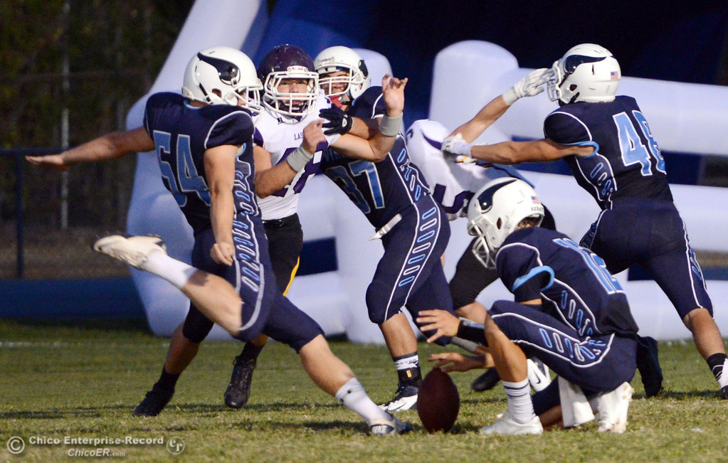 . Pleasant Valley High\'s #54 Zack Gillam kicks the extra point against Lassen High in the first quarter of their football game at PVHS Asgard Yard Friday, September 6, 2013 in Chico, Calif. (Jason Halley/Chico Enterprise-Record)