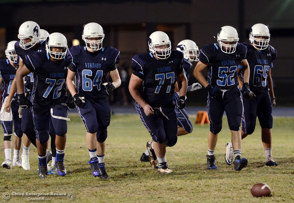 . Pleasant Valley High\'s #72 Christian Darden, #64 Chase Jacobsen, #77 Tyler Stimac, #52 Riley Andrew, and #65 Michael Walker (left to right) ready against Lassen High in the fourth quarter of their football game at PVHS Asgard Yard Friday, September 6, 2013 in Chico, Calif. (Jason Halley/Chico Enterprise-Record)