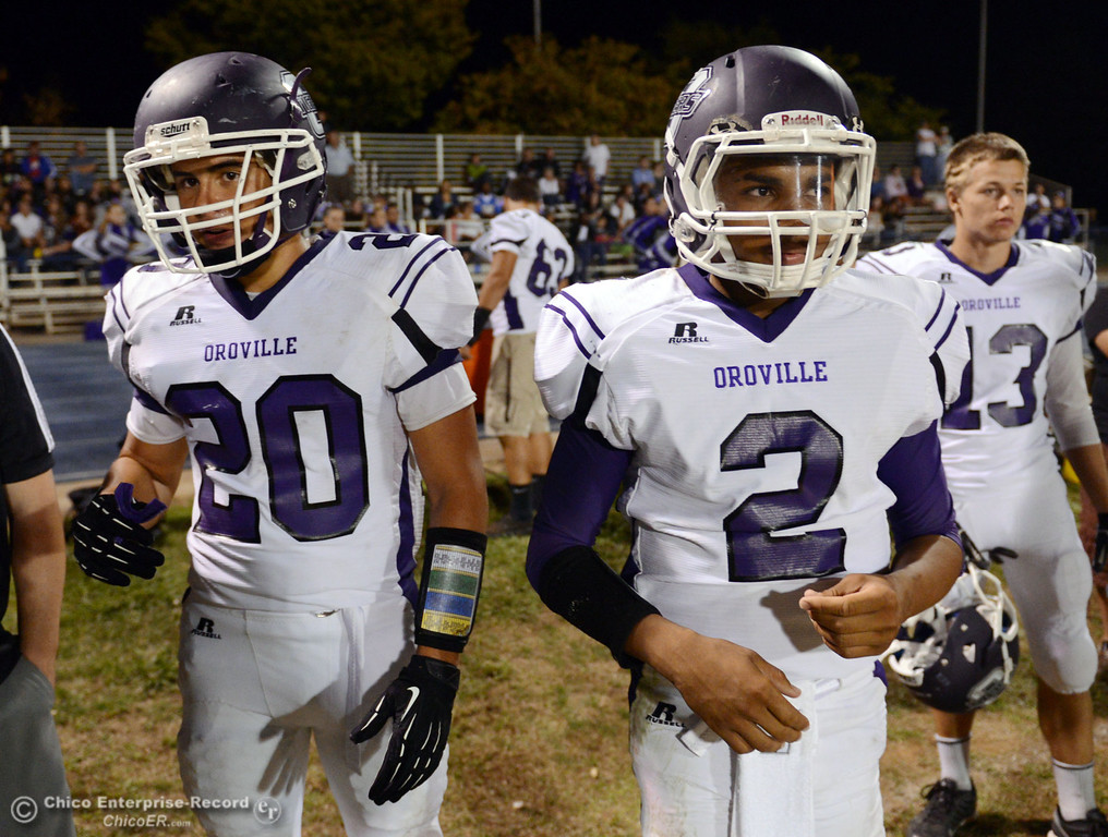 . Oroville High\'s #20 Brandon Tewksbury (left) and #2 Marcus Wilhite (right) against Pleasant Valley High in the fourth quarter of their football game at PVHS Asgard Yard Friday, September 20, 2013, in Chico, Calif. (Jason Halley/Chico Enterprise-Record)