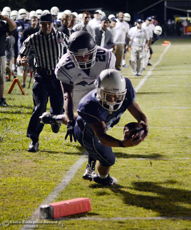 . Pleasant Valley High\'s #30 Connor Melton (front) rushes for a touchdown against Oroville High\'s #20 Brandon Tewksbury (back) in the second quarter of their football game at PVHS Asgard Yard Friday, September 20, 2013, in Chico, Calif. (Jason Halley/Chico Enterprise-Record)