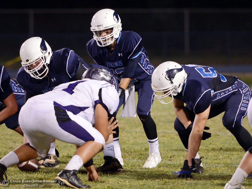 . Pleasant Valley High\'s #12 Trent Darms (center) readies the snap against Oroville High in the first quarter of their football game at PVHS Asgard Yard Friday, September 20, 2013, in Chico, Calif. (Jason Halley/Chico Enterprise-Record)