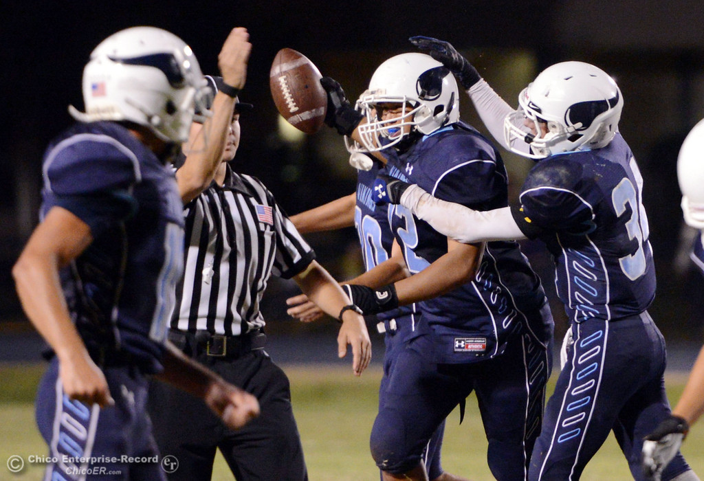 . Pleasant Valley High\'s #72 Christian Darden (center) reacts to a fumble recovery against Oroville High in the second quarter of their football game at PVHS Asgard Yard Friday, September 20, 2013, in Chico, Calif. (Jason Halley/Chico Enterprise-Record)