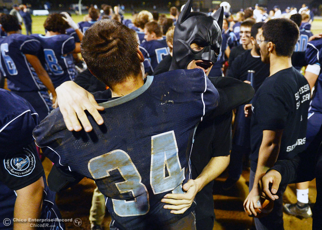 . Pleasant Valley High celebrates their win against Shasta High at the end of the fourth quarter of their football game at PVHS Asgard Yard Friday, October 18, 2013 in Chico, Calif.  (Jason Halley/Chico Enterprise-Record)