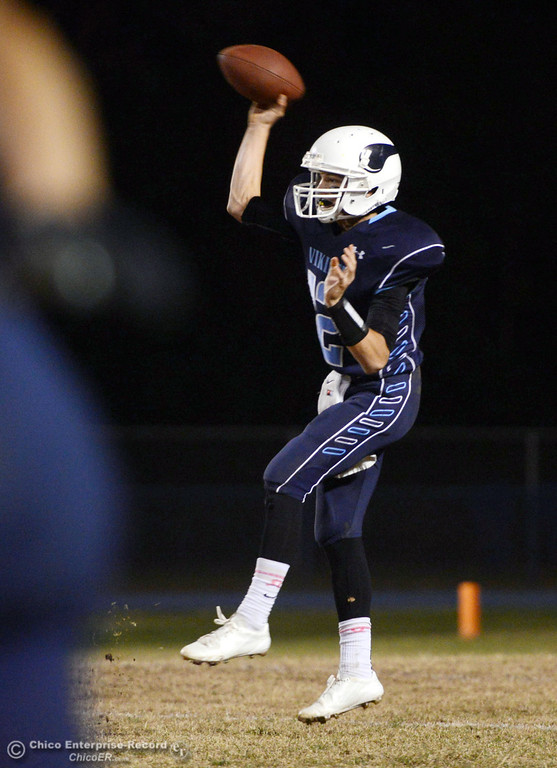 . Pleasant Valley Highs\' #12 Trent Darms throws a pass against Shasta High in the second quarter of their football game at PVHS Asgard Yard Friday, October 18, 2013 in Chico, Calif.  (Jason Halley/Chico Enterprise-Record)