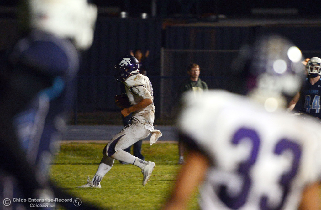 . Shasta High\'s #18 Bailey Odell runs in for a touchdown against Pleasant Valley in the fourth quarter of their football game at PVHS Asgard Yard Friday, October 18, 2013 in Chico, Calif.  (Jason Halley/Chico Enterprise-Record)